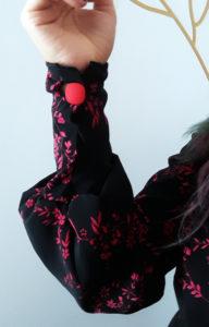 macnche bouffante avec bouton rouge